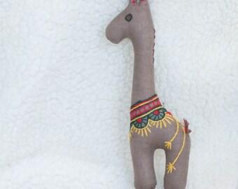 Stuffed giraffe. Little soft toy.