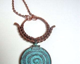 Copper wire wrapped blue patina spiral necklace