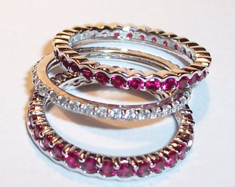 Ruby red and clear CZ stack rings. Three silver stack rings. Red and clear eternity band rings. Size 7 ruby and diamond simulated rings.