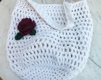 Large crocheted shoulder bag with rose detail made with bamboo yarn and lined with faux silk.