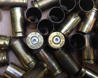 Twenty (20) 9mm shells; Empty pistol shells