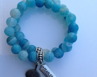 Blue frosted beads, charms