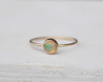 14 k yellow Gold stackable Ring with Welo Opal