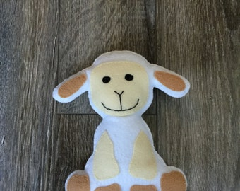 Larry the lamb, lamb plushie, lamb stuffed toy.