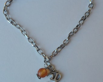 Om symbol and orange agate chain bracelet. Silver chain bracelet with Om symbol charm and semi-precious agate orange color