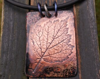 Pendant of copper sheet with print of the Japanese wine Berry