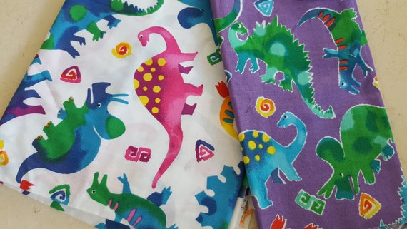 Dinosaur fabric rainbow rascals by hoffman for Purple dinosaur fabric