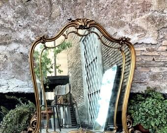 Golden wood framed wall mirror