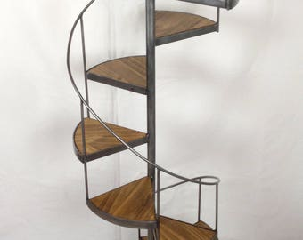 Small staircase spiral staircase in metal and wood