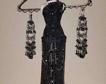 Mannequin jewelry stand with beaded earrings