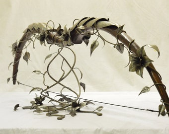 "Handcarved Longbow, wrapped in steel vines and flowers. ""Nettleborn Bow"". Display only."