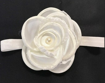 Lovely, simple ivory/cream baby/infant/preemie elastic headband. One ivory flower is on matching elastic headband. Pearl in center of flower