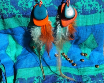 Earrings handmade with feathers and coloured seeds