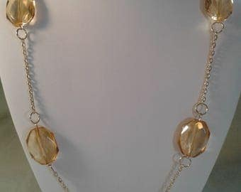 Long gold chain with light topaz glass beads