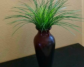 artificial grass in a beautiful vase.