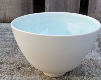 Wheel Thrown Porcelain Bowl with Ice Blue Glaze and Naked Exterior