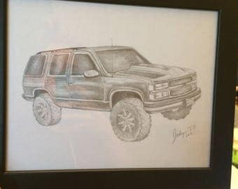 Hand drawn framed graphite sketch of vehicle