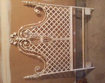 Antique cast iron head board