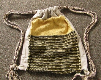 Upcycled and Reconstructed Jean Drawstring Bag With a Bright Knit pocket front.