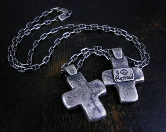 Primitive sterling silver sand cast cross with a deep rustic patina.