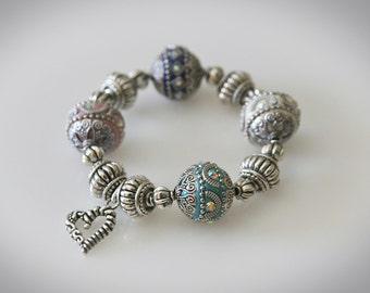 Chunky Beaded Stretch Bracelet. Ornate Indonesian and Silver Beads