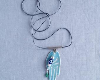 MYSTIC HAND necklace, palmistry, hamsa, evil eye, turquoise aqua glaze, white porcelain, long grey leather thong, rose gold zamak bail, bead