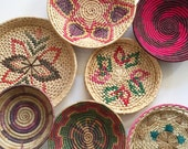 vintage woven wall hanging coiled textile basket / decorative / butterfly / african