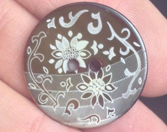 Brown shell buttons with floral transfer design, matched set of 5.  Size 1""
