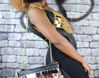 RIZZO giant rose gold sequin handbag. Black quilted leather.