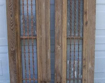 antique pediment windows with iron panels;salvage windows,wood windows,hand carved window panels,architectural windows,decorative wall art