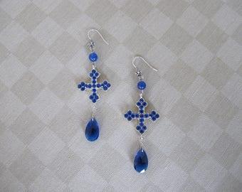 Blue cross and tear shaped bead earrings