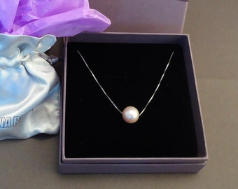 Silver necklace with a floating pink freshwater pearl