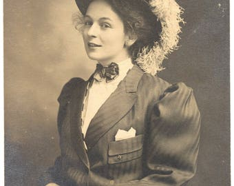 Photo of Pretty Woman Wearing Suit and Plumed Hat 1910s