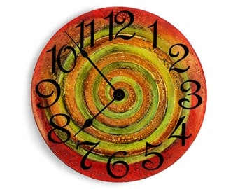 Red clock with lime green and rust swirl.