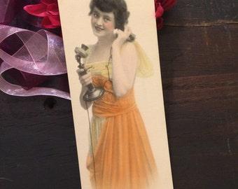Lovely c 1920 Art Print Ad Card, Brunette Flapper on Old Fashioned Phone, Telephone, Orange Yellow Dress, Wall Art Decor