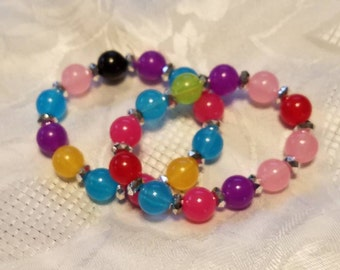 Two individual muti colored beaded bracelets