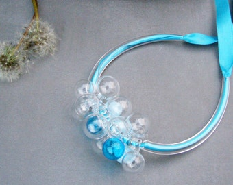 Bubble glass necklace with blue satin ribbon