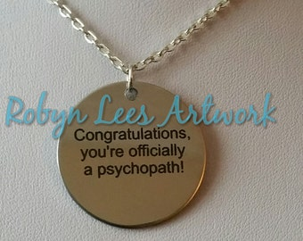 Congratulations, You're Officially A Psychopath! Engraved Stainless Steel Disc Necklace on Silver Chain or Black Faux Suede Cord. Humour