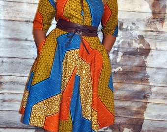 Kasi classic shirt dress in brown blue and orange hues.