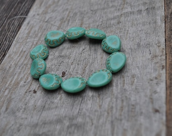 Turquoise Stone Beads with Gold Detailing