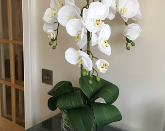 Beautiful artificial real touch white orchids with lush foliage set in a gorgeous 14cm mirror cube