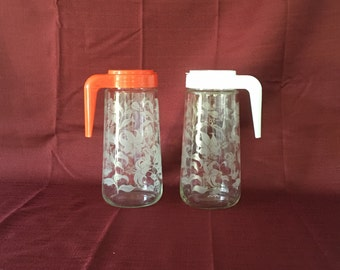 Vintage Glass Carafes   Plastic Lid   Matching Set of Two   36 Fluid Ounces   Tang