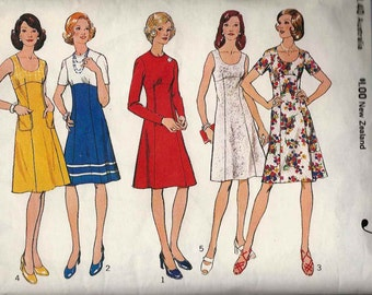 Style 4621 Shaped dress high or scoop neck fitted bodice empire waist flared skirt with/out sleeves Size 14 sewing pattern