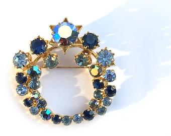 Brooch Goldtone Aurora Borealis with Blue and Blue Green Rhinestones Star Wreath Made in Austria
