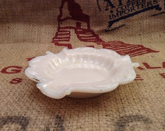 Very pretty pink milk glass decorative ash tray