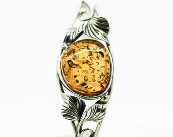 A Silver Amber Bangle With Decorated With A Leaf Design   SKU425