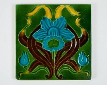 Antique 1900s English Art Nouveau blue daffodil pottery tile.