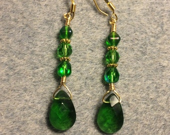 Bright green Czech glass briolette dangle earrings adorned with bright green Czech glass beads.