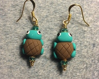 Teal and brown polymer clay turtle bead earrings adorned with teal Chinese crystal beads.