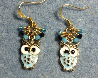 Turquoise and white enamel and rhinestone owl charm dangle earrings adorned with tiny dangling turquoise and black Chinese crystal bead.